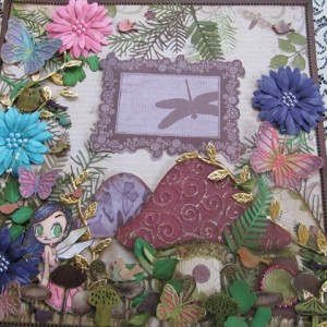 Layout by DT Member Laura Luyando using Diemond Dies Sunflower Set. Pine Branch Die, and Small and Large Monarch Butterfly Dies